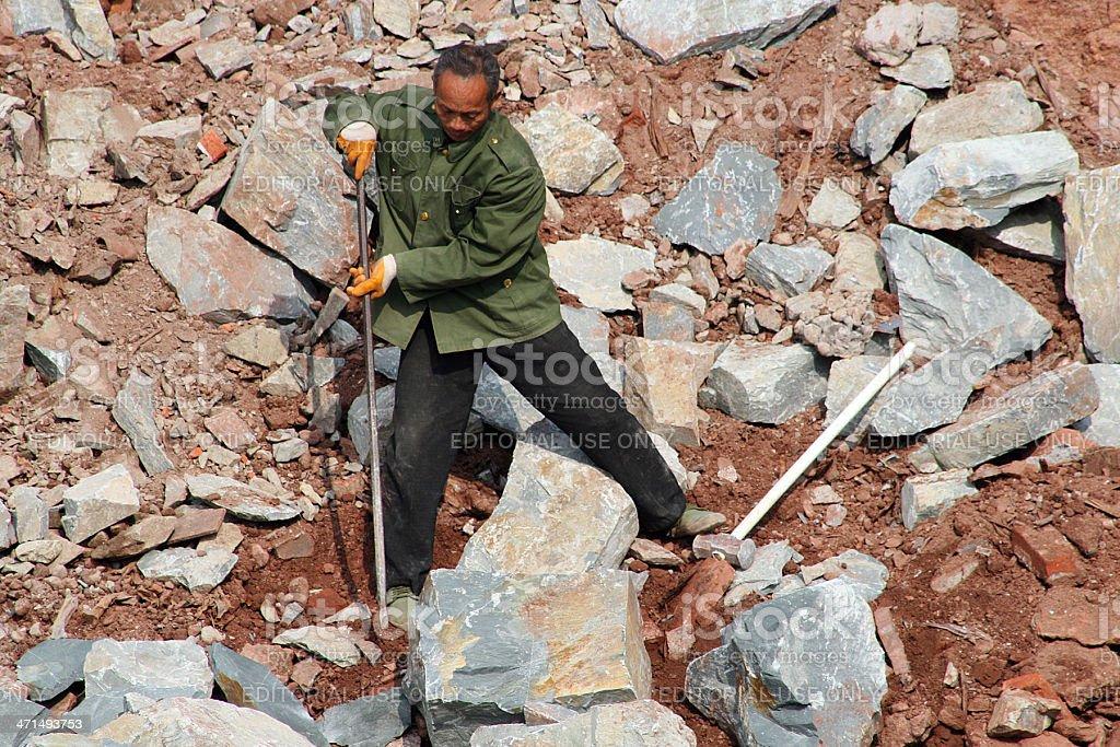Uomo di Rocks, Cina foto stock royalty-free