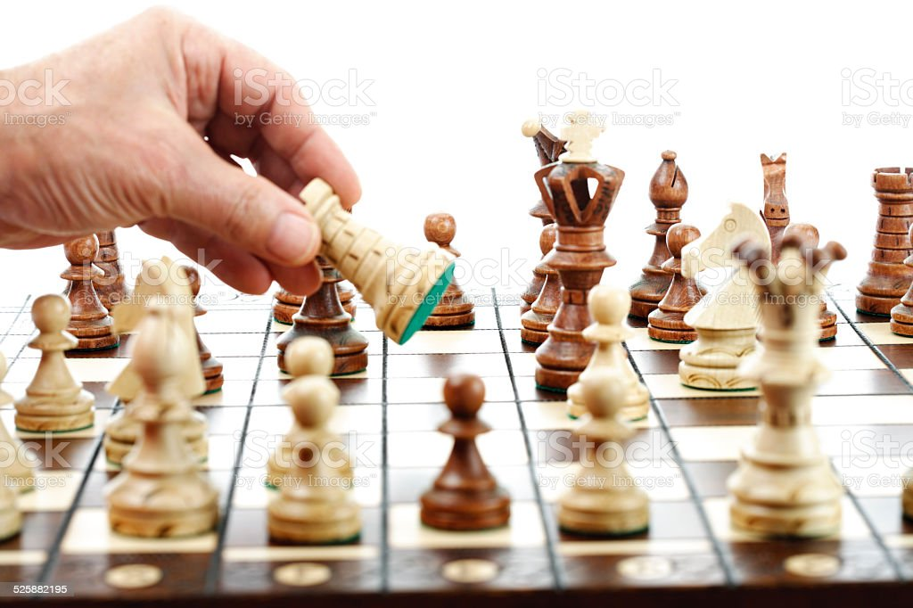 Man moving rook on chessboard stock photo