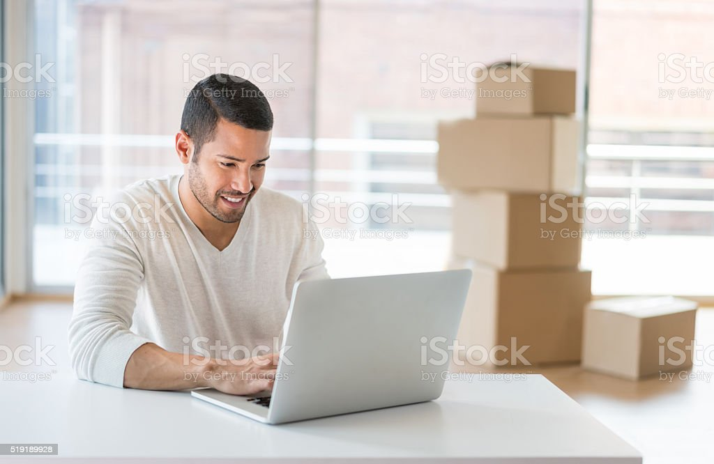 Man moving to a new office stock photo