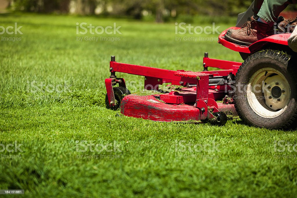 Man mowing lawn stock photo