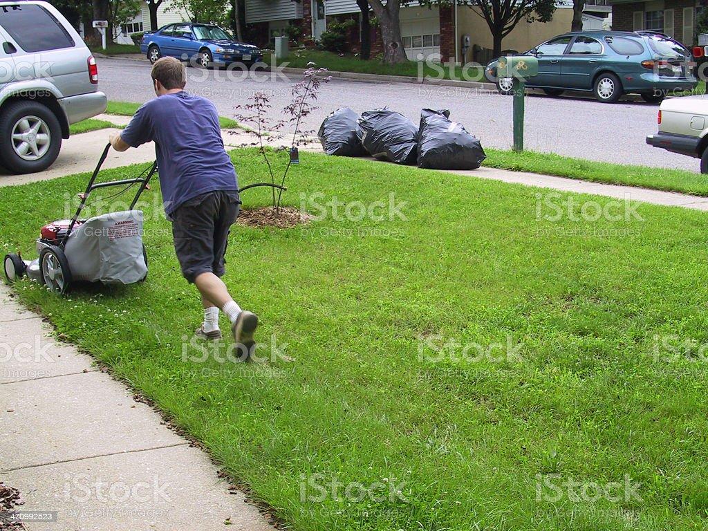 Man mowing yard royalty-free stock photo