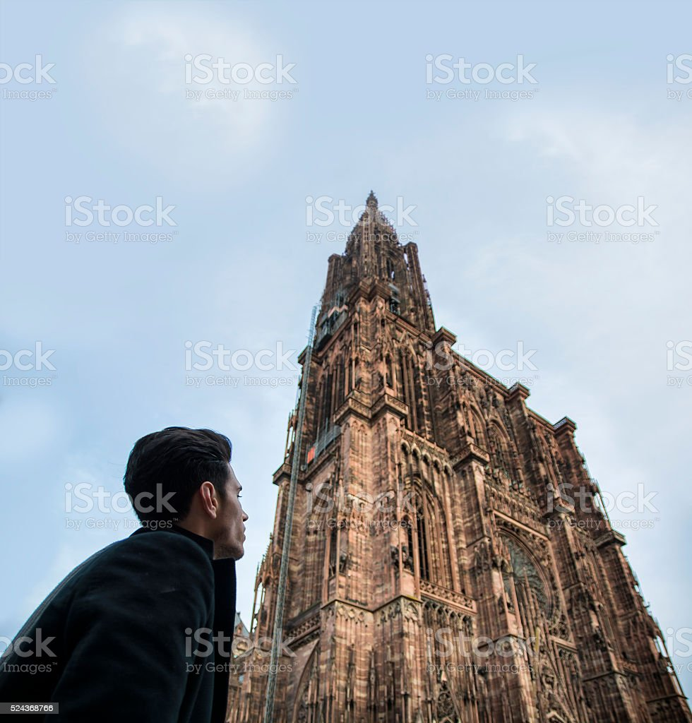 Man near Cathedral of Strasbourg in France stock photo