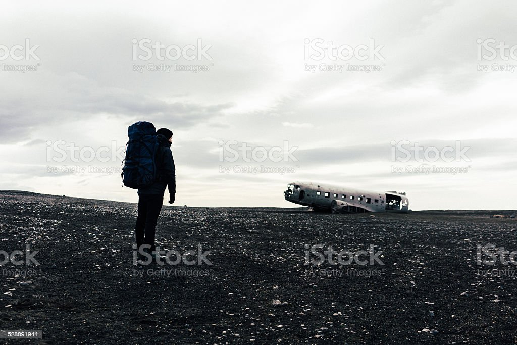 Man near the broken airplane stock photo