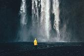 Man near the waterfall