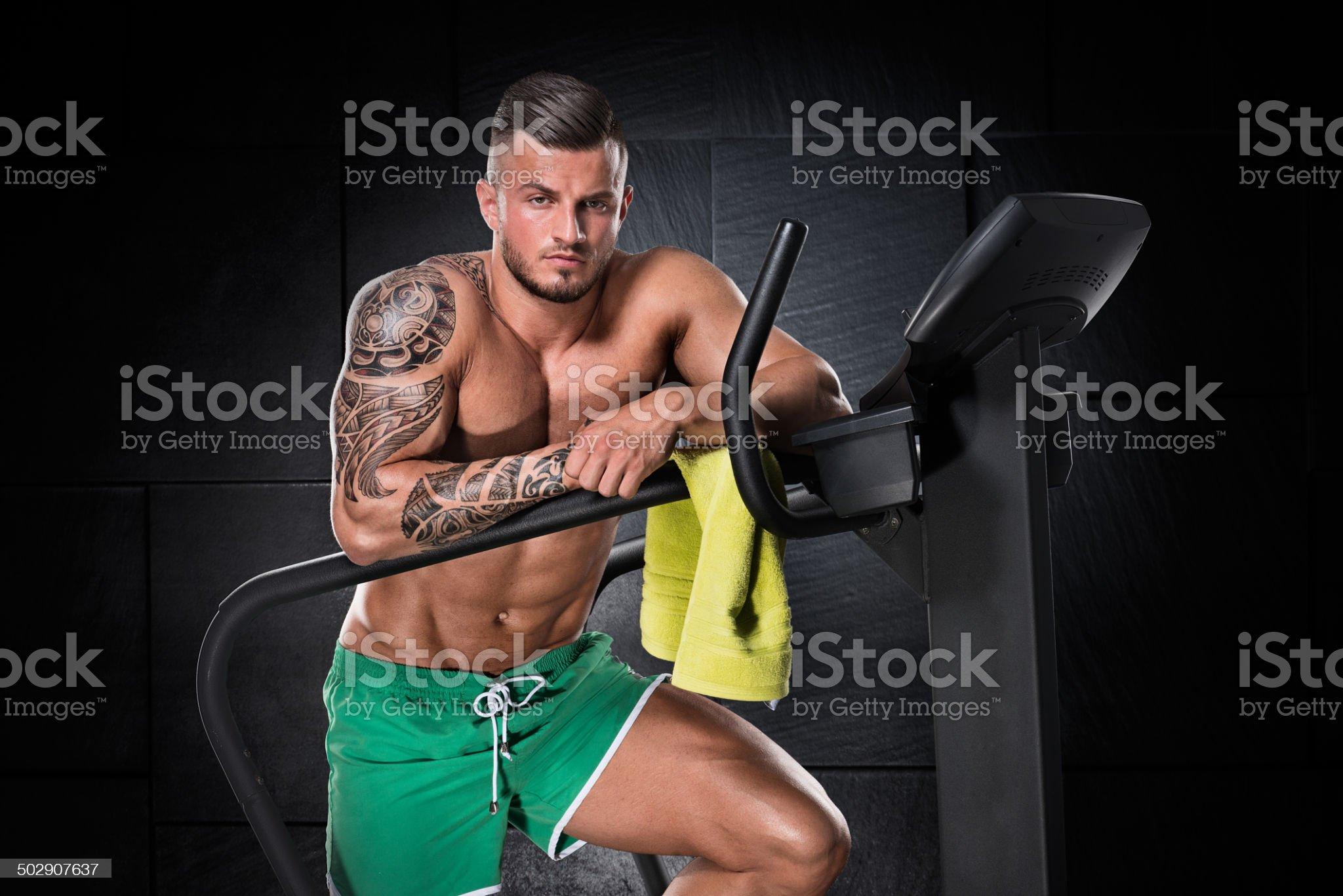 Man next to stepping machine royalty-free stock photo