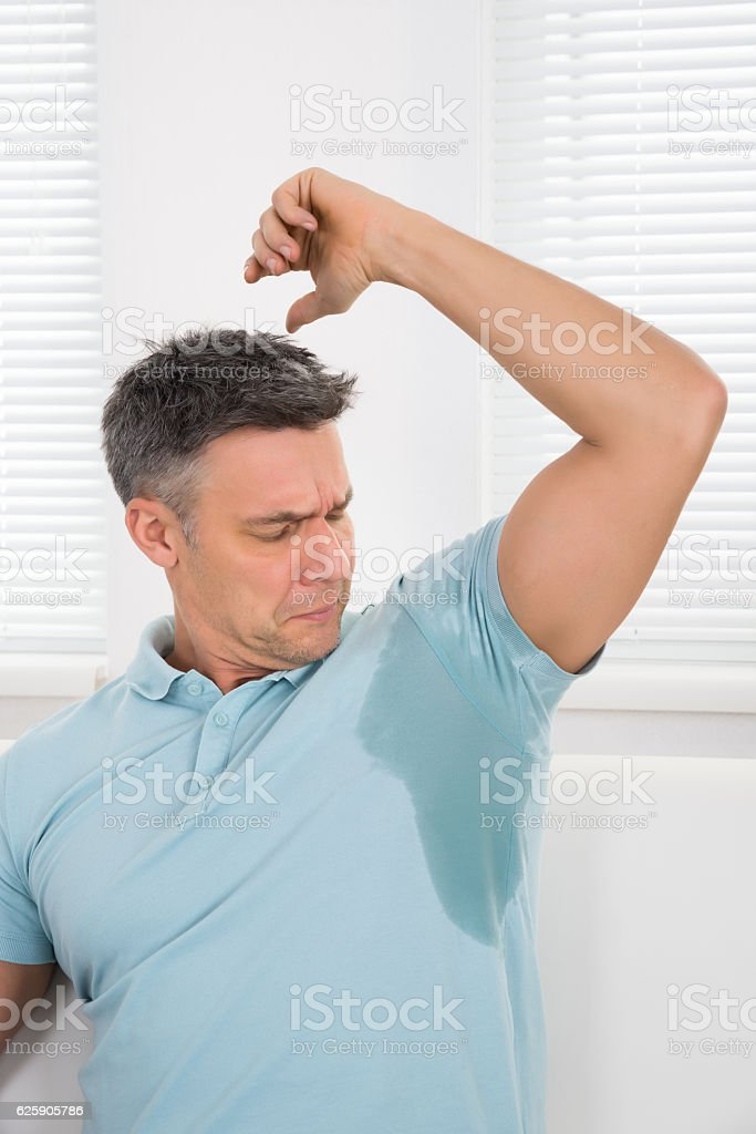 Man Notices His Sweat stock photo