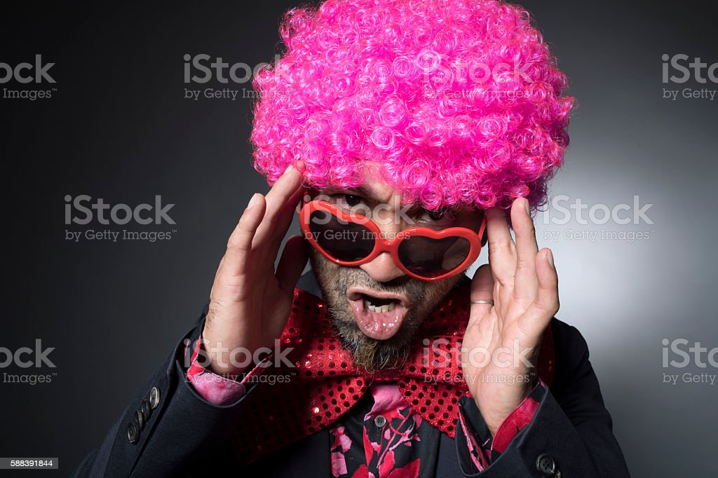 Man of Afro angry by shifting the sunglasses stock photo