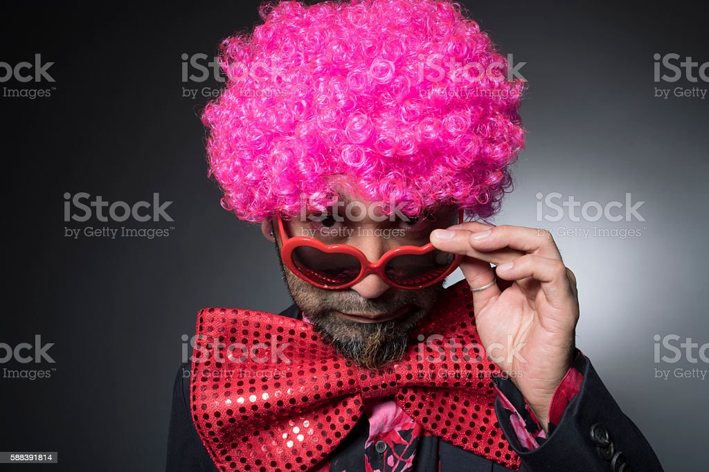 Man of Afro looking shifting the sunglasses stock photo