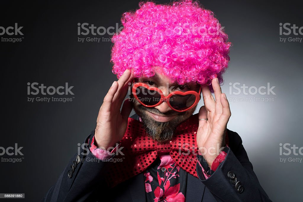 Man of Afro smiling by shifting the sunglasses stock photo