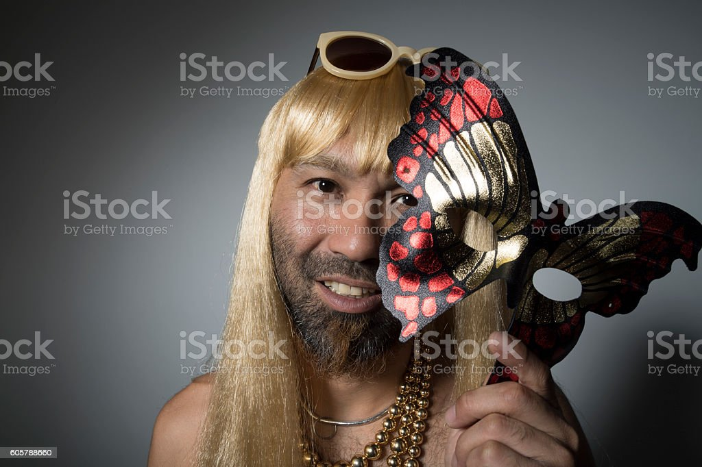 Man of bearded has the mask of the butterfly. stock photo