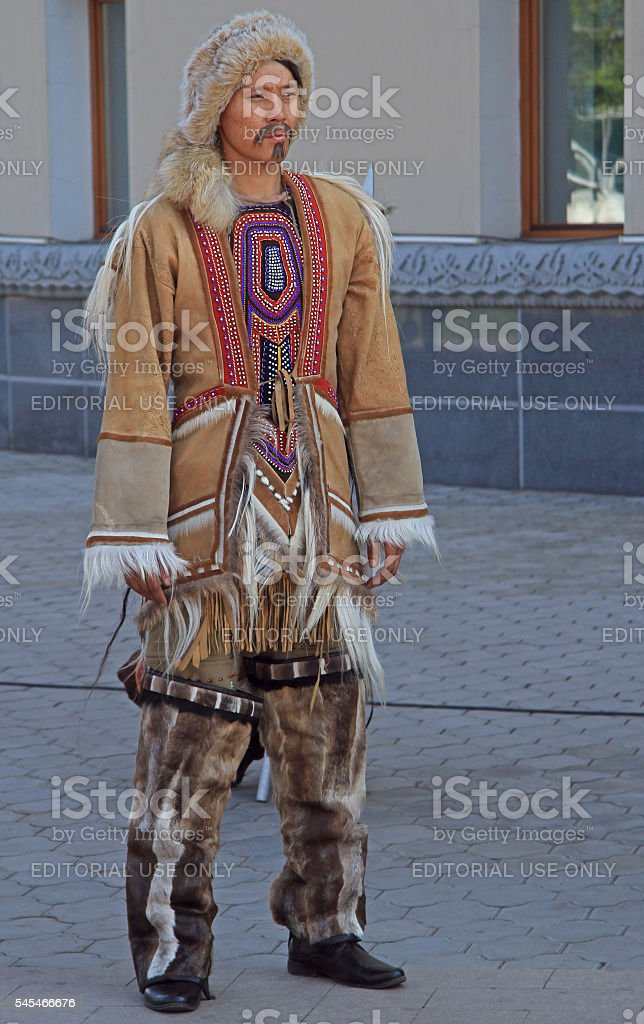 man of indigenous small numbered people is standing outdoor stock photo