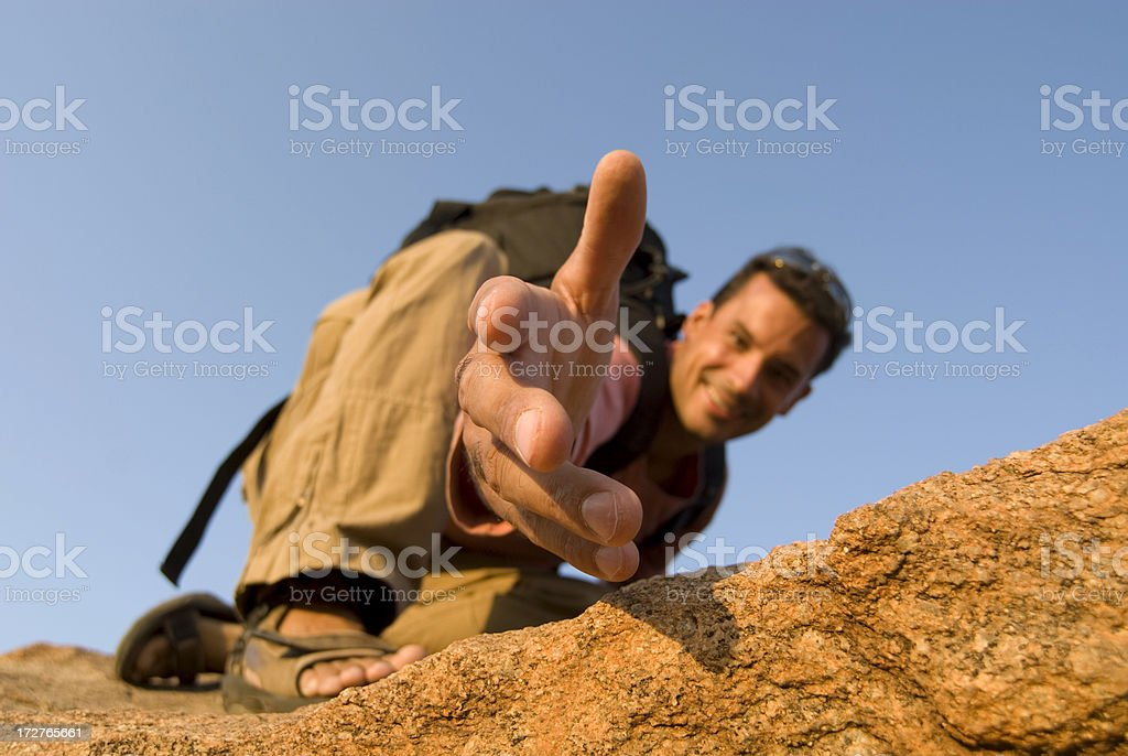 Man offering a hand up royalty-free stock photo