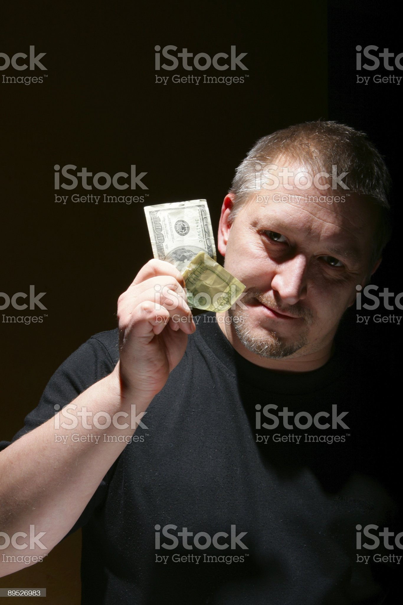 Man offering money royalty-free stock photo