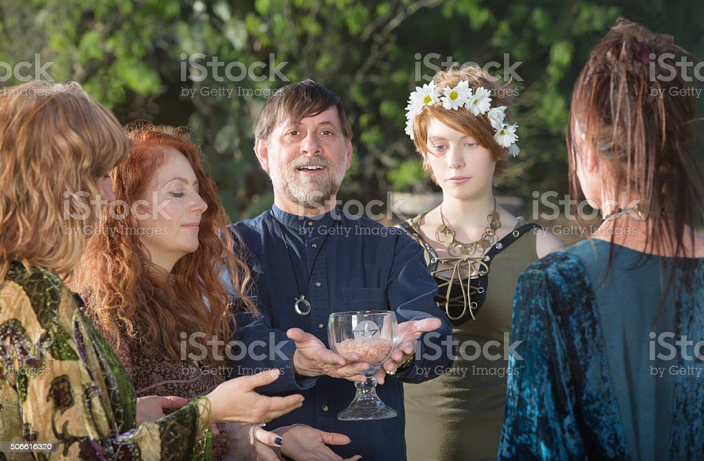 Man Offering Ritual Goblet stock photo