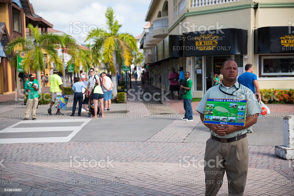 Man offering tours and beach transport on St. Kitts stock photo