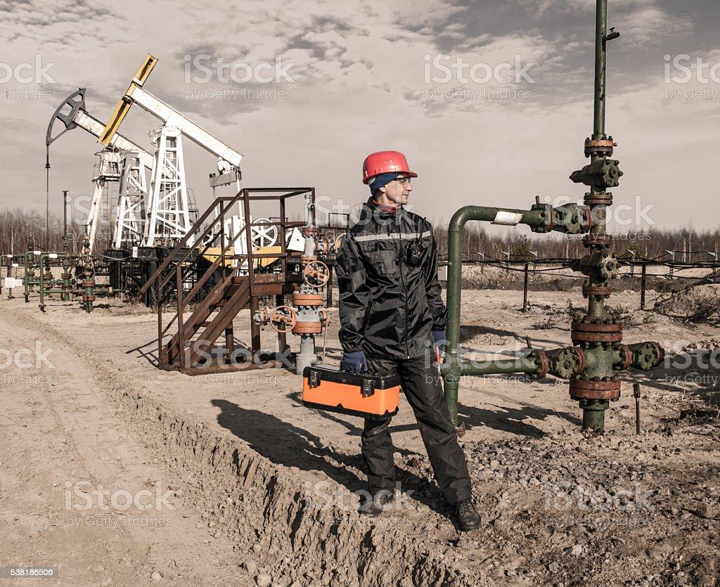 Man oilfield stock photo