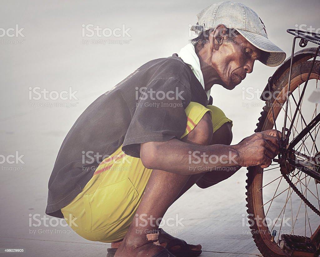 man old repair  bicycle stock photo
