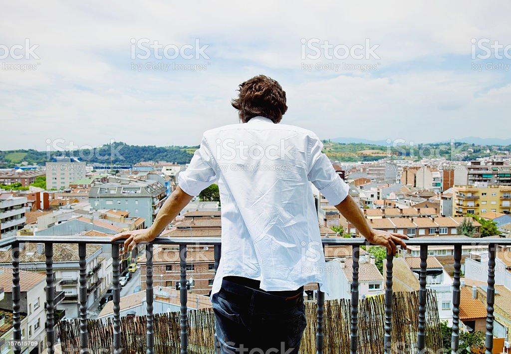Man on a balcony stock photo