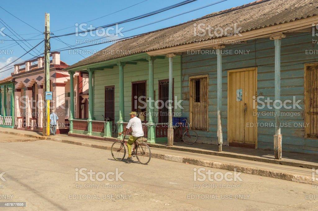 Man on a bike in a street in Baracoa, Cuba stock photo