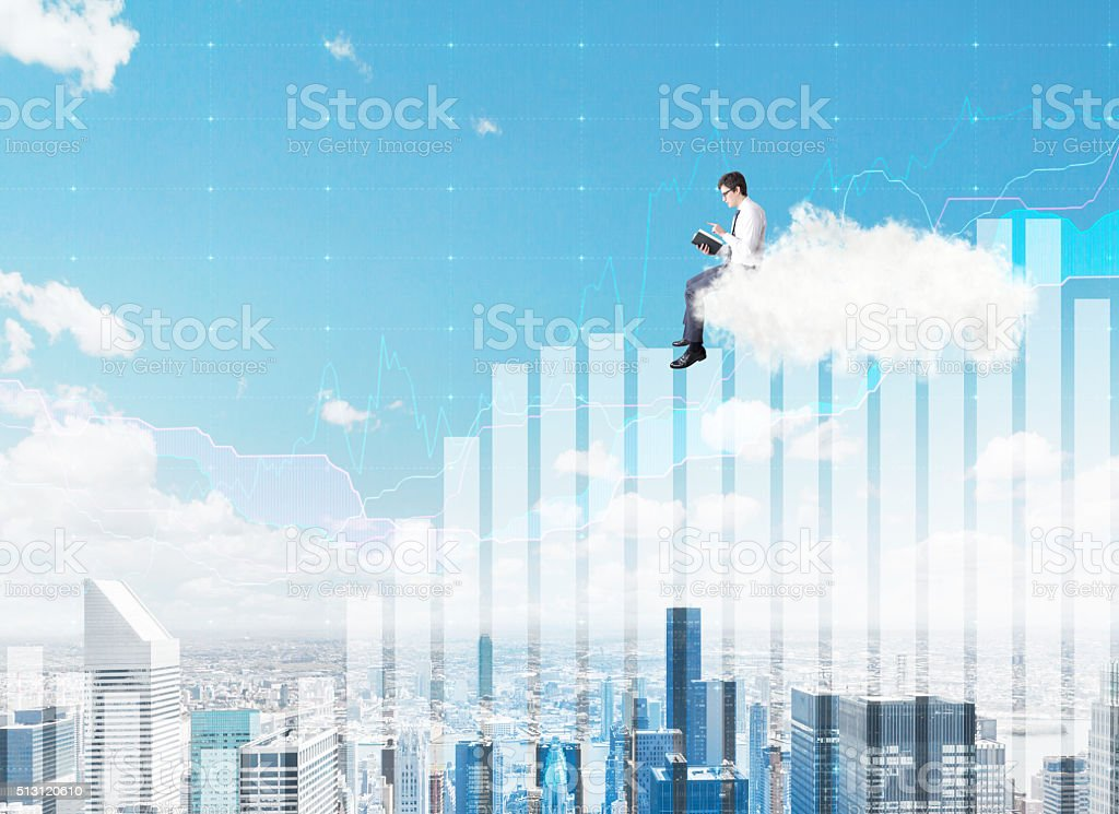 Man on a cloud reading a book stock photo
