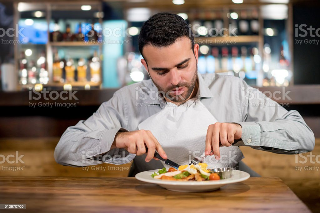 Man on a diet eating at a restaurant stock photo