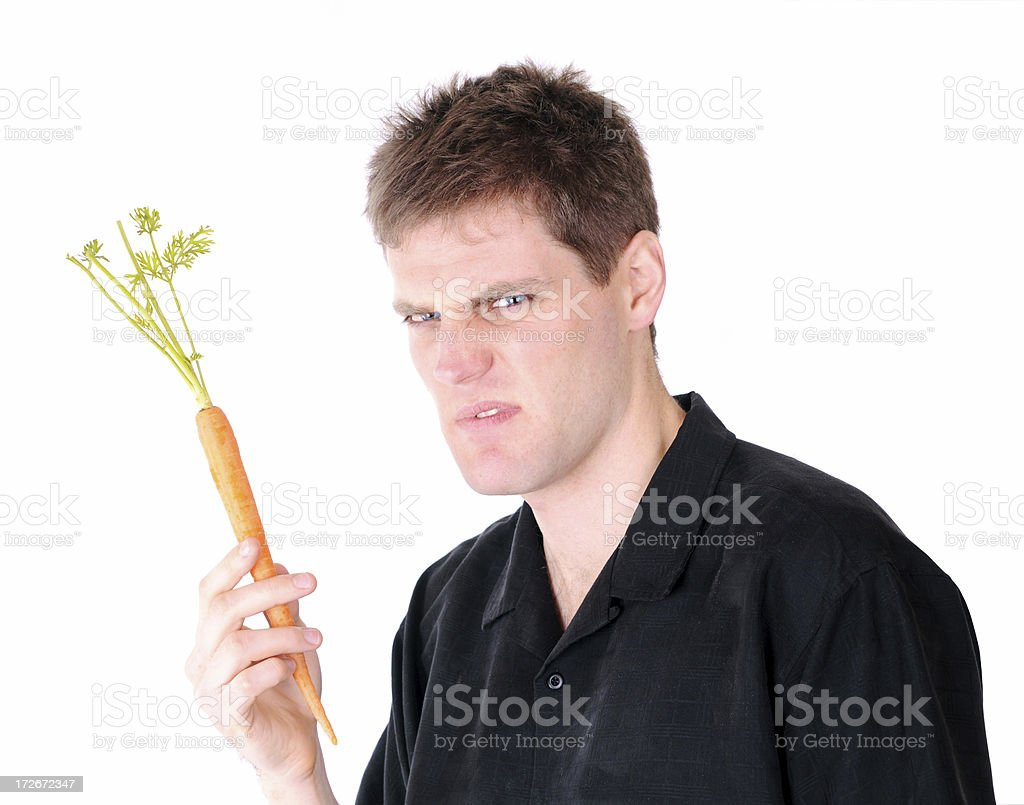 Man on a Diet Series: Carrot Displeasure stock photo