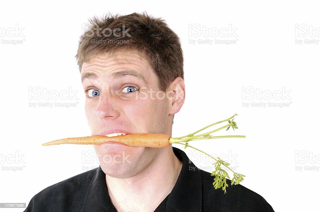 Man on a Diet Series: Carrot in the Mouth stock photo