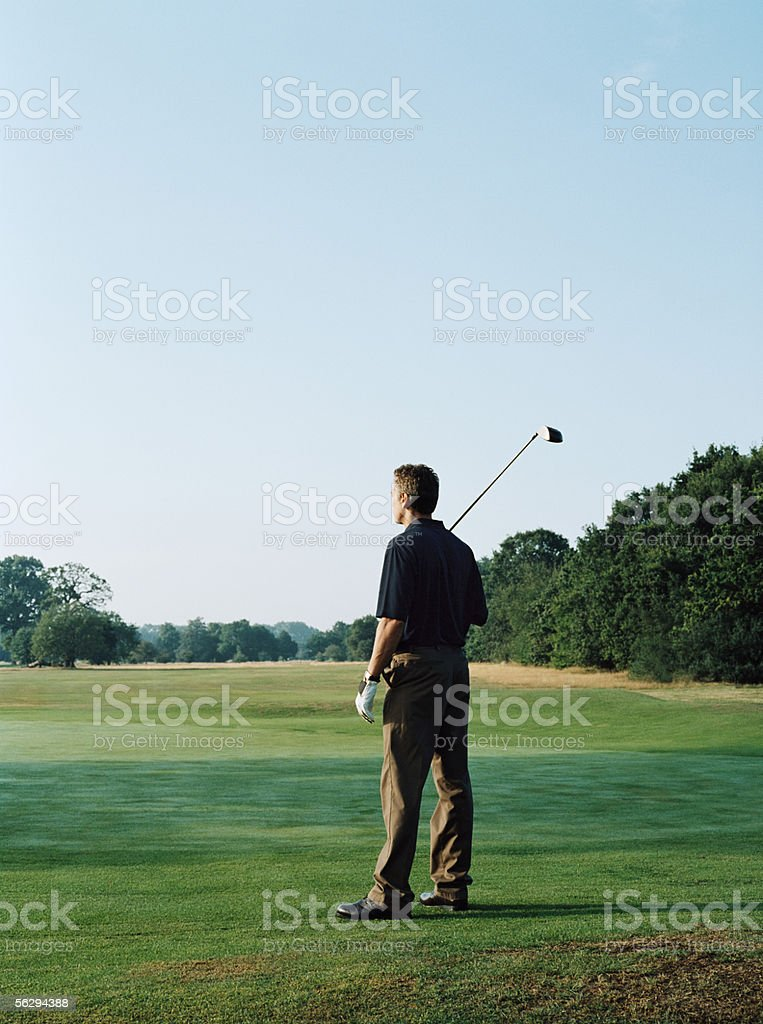 Man on a golf green stock photo