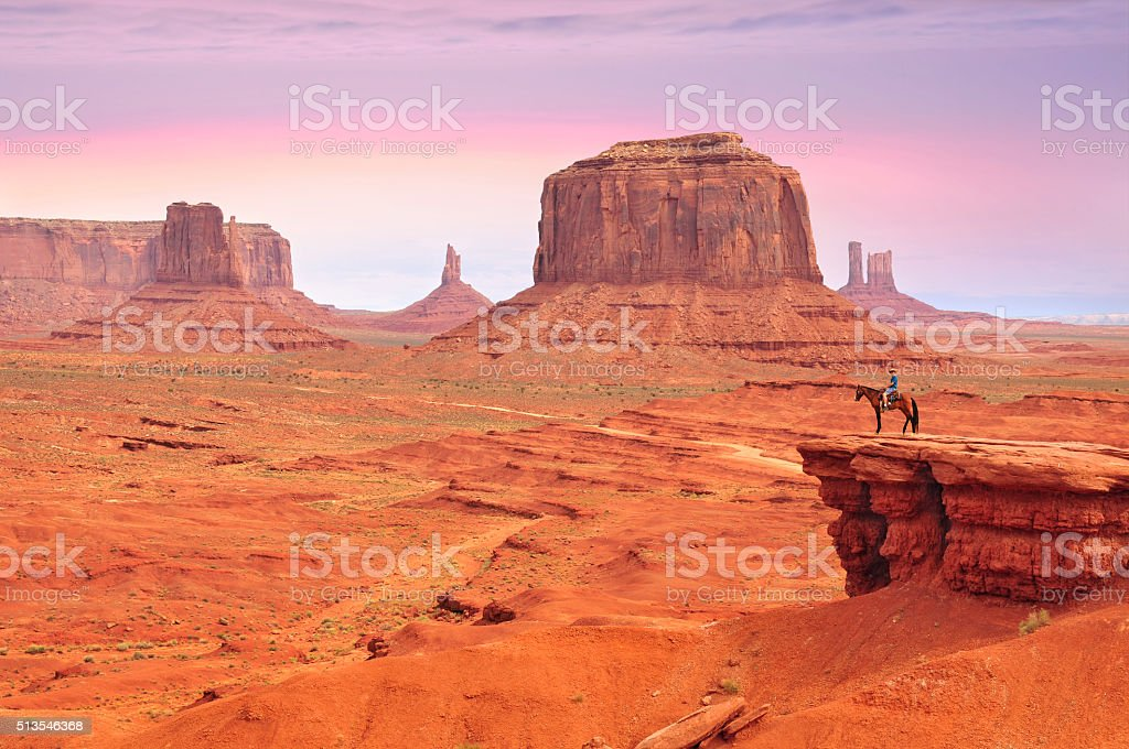 Man on a horse in Monument Valley stock photo