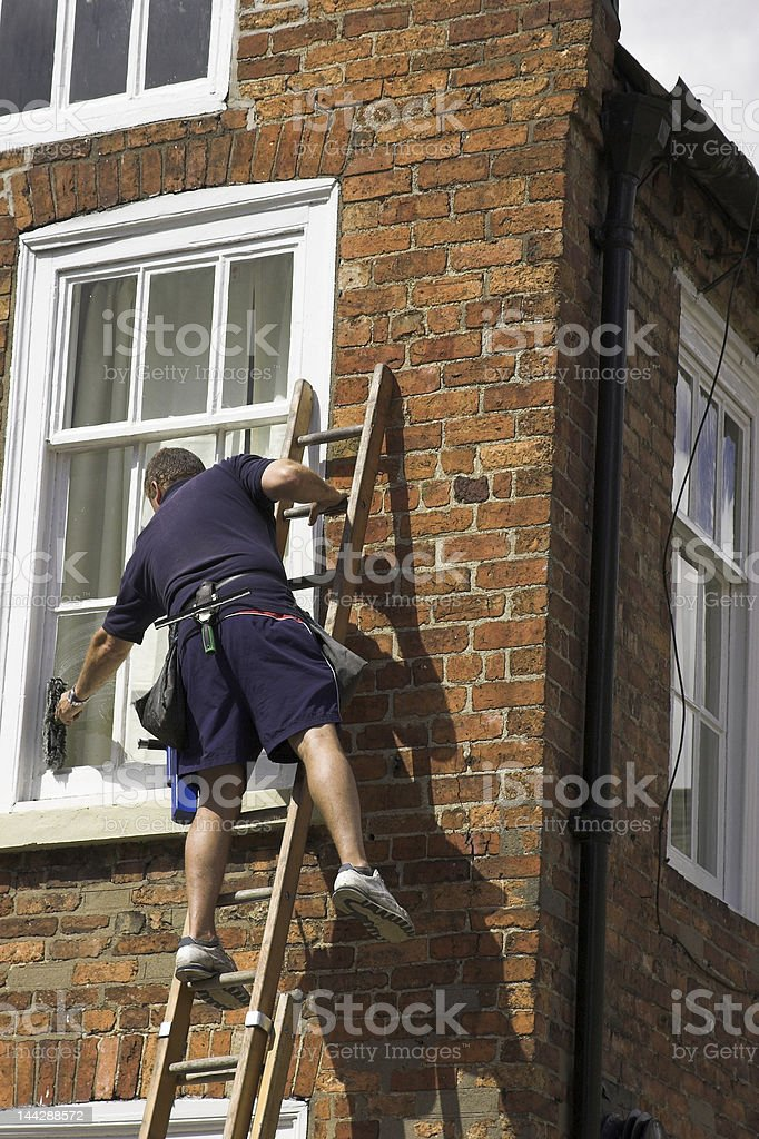 Man On A Ladder stock photo