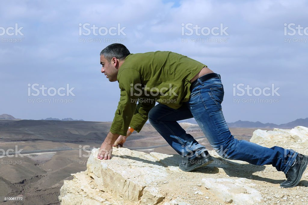 Man On A Ledge - starting line position stock photo