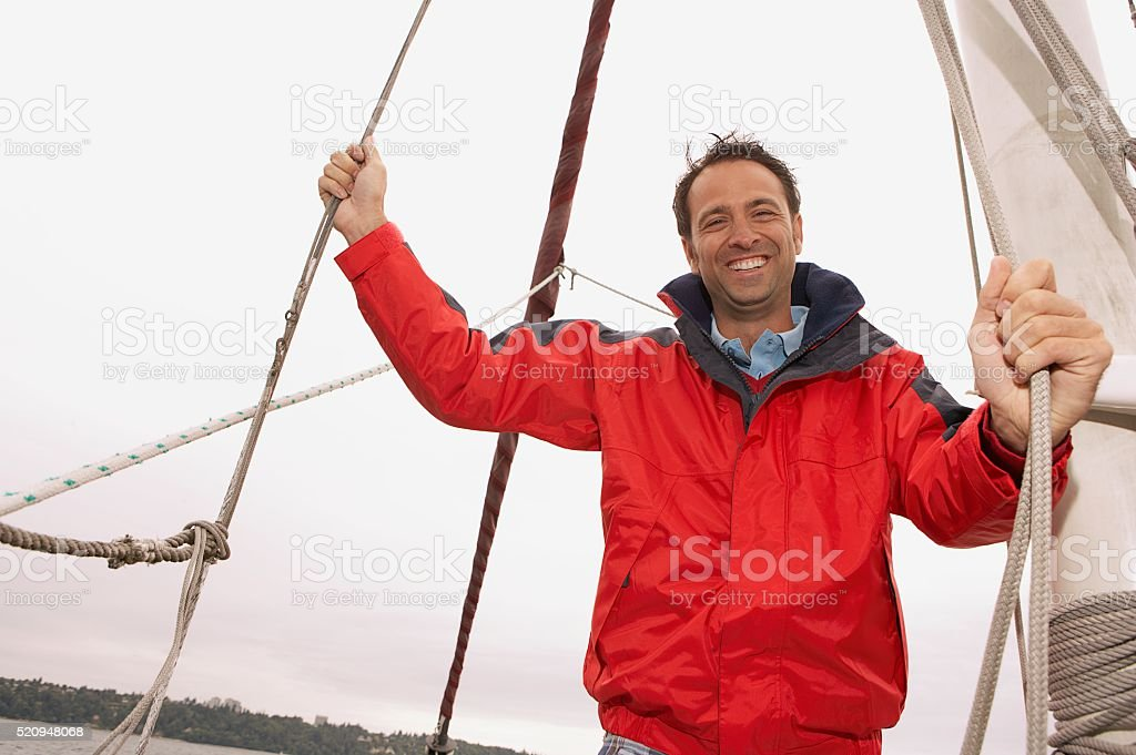 Man on a sailboat stock photo