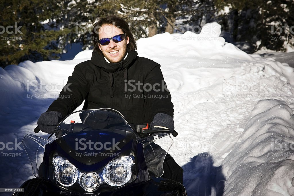 Man on a snowmobile royalty-free stock photo