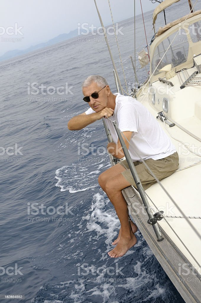 Man on a yacht looking at the sea royalty-free stock photo