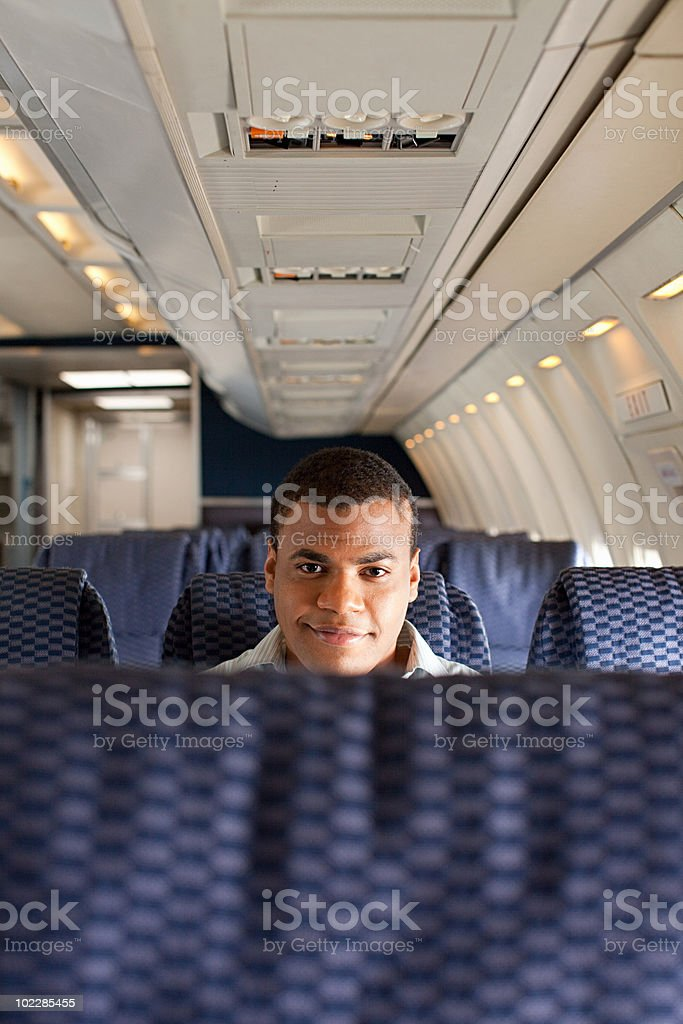 Man on an airplane royalty-free stock photo