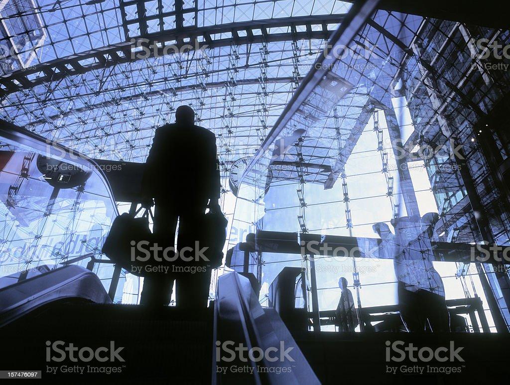 Man on an escalator at a modern train station. royalty-free stock photo