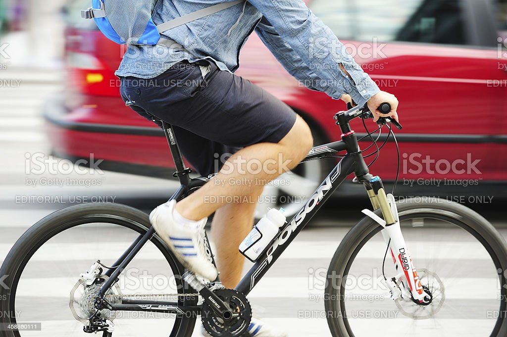 Man on bicycle in profile stock photo