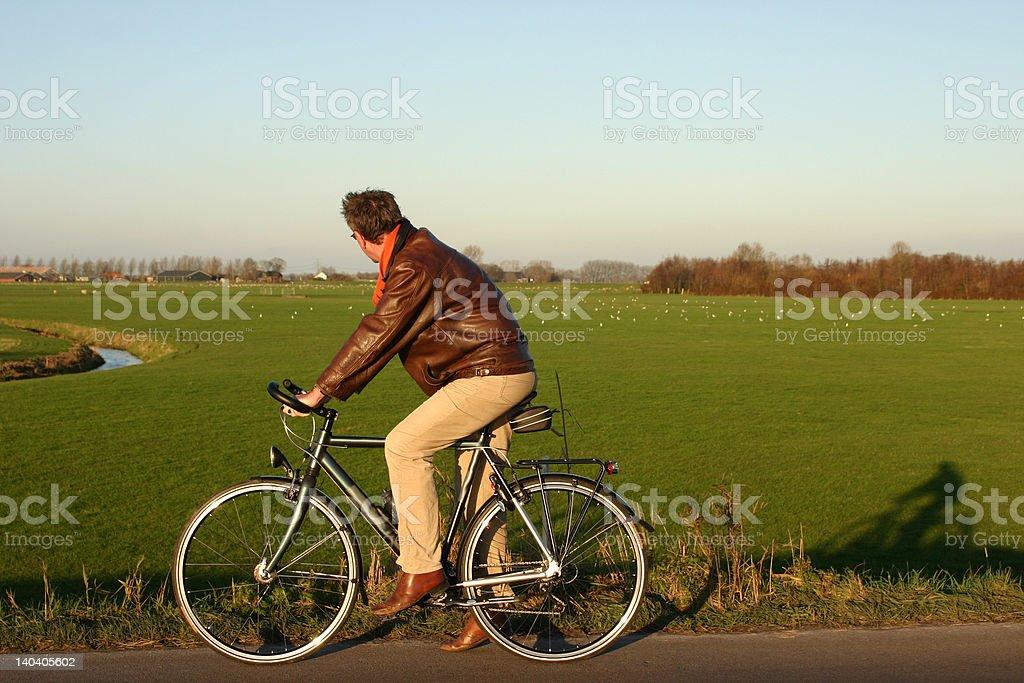 man on bicycle stock photo