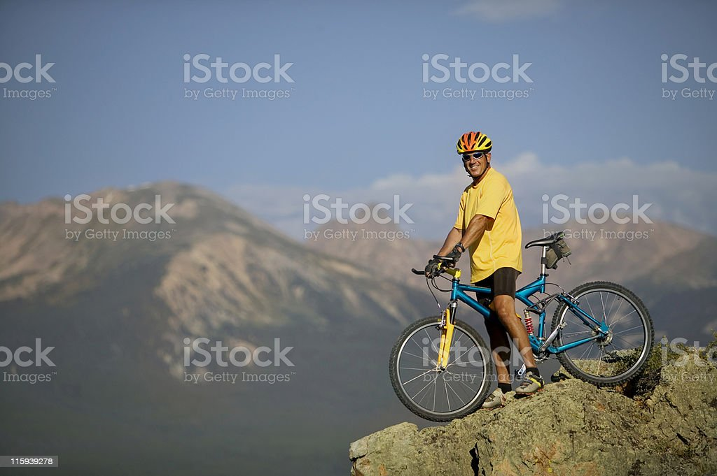 Man on Bicycle Resting in Mountains royalty-free stock photo