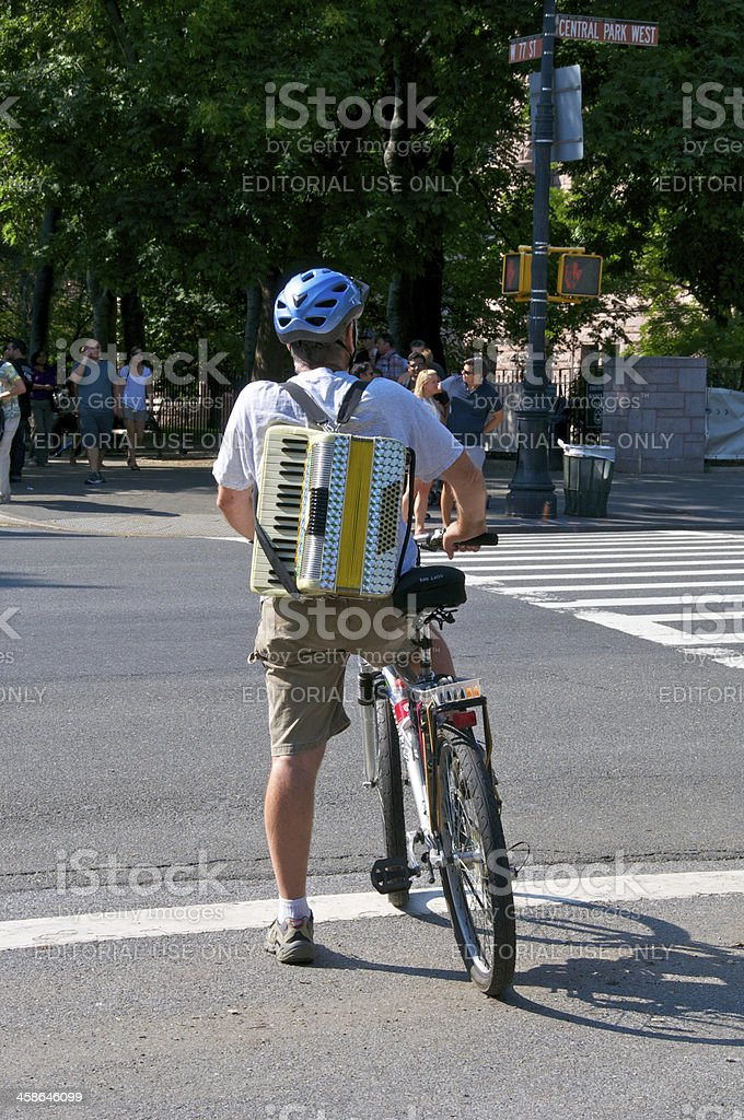 Man on bicycle with an accordion, Manhattan, NYC stock photo