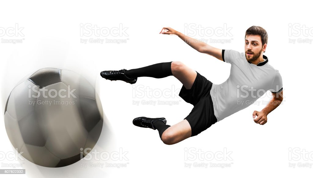 Man on black and white uniform playing soccer stock photo