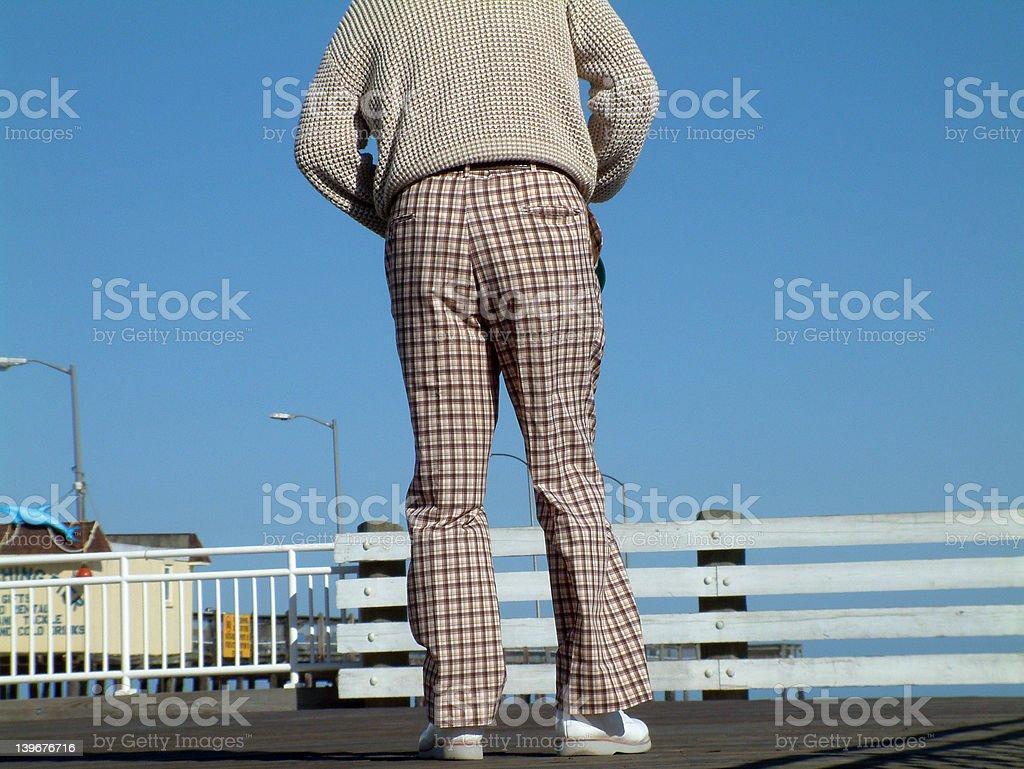 Man on boardwalk in plaid pants royalty-free stock photo