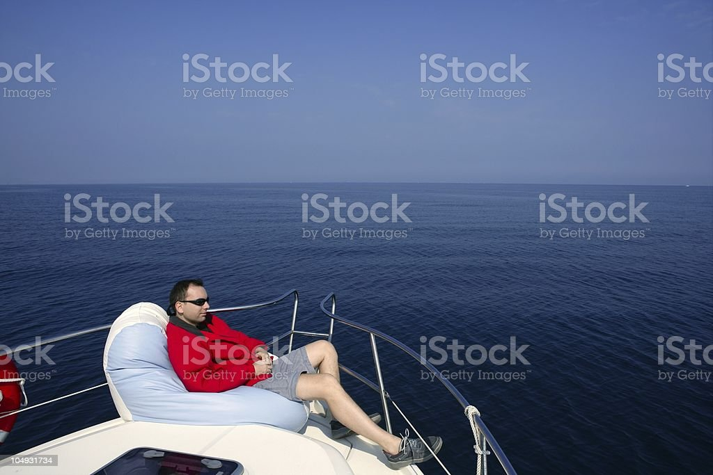 Man on bow boat relaxed sit over bean bag royalty-free stock photo