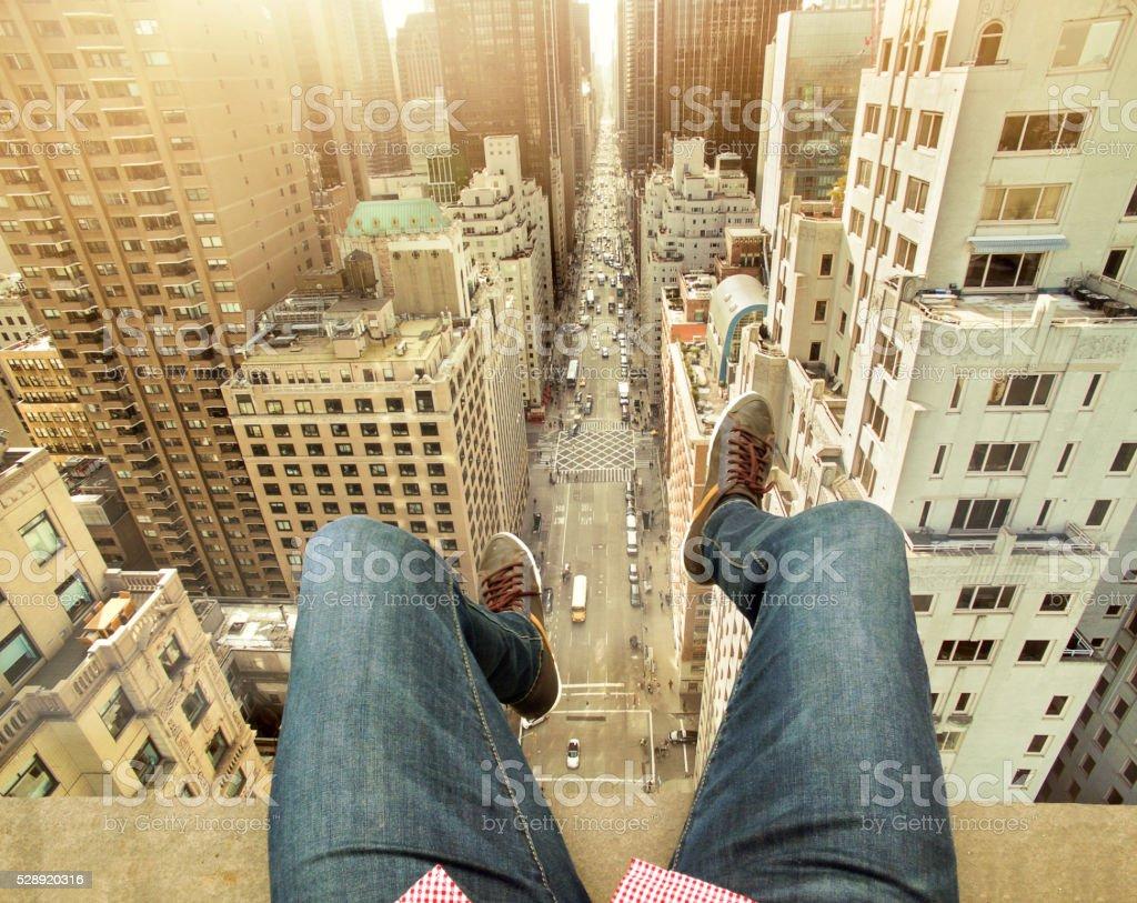 Man On Building Terrace Above New York City stock photo