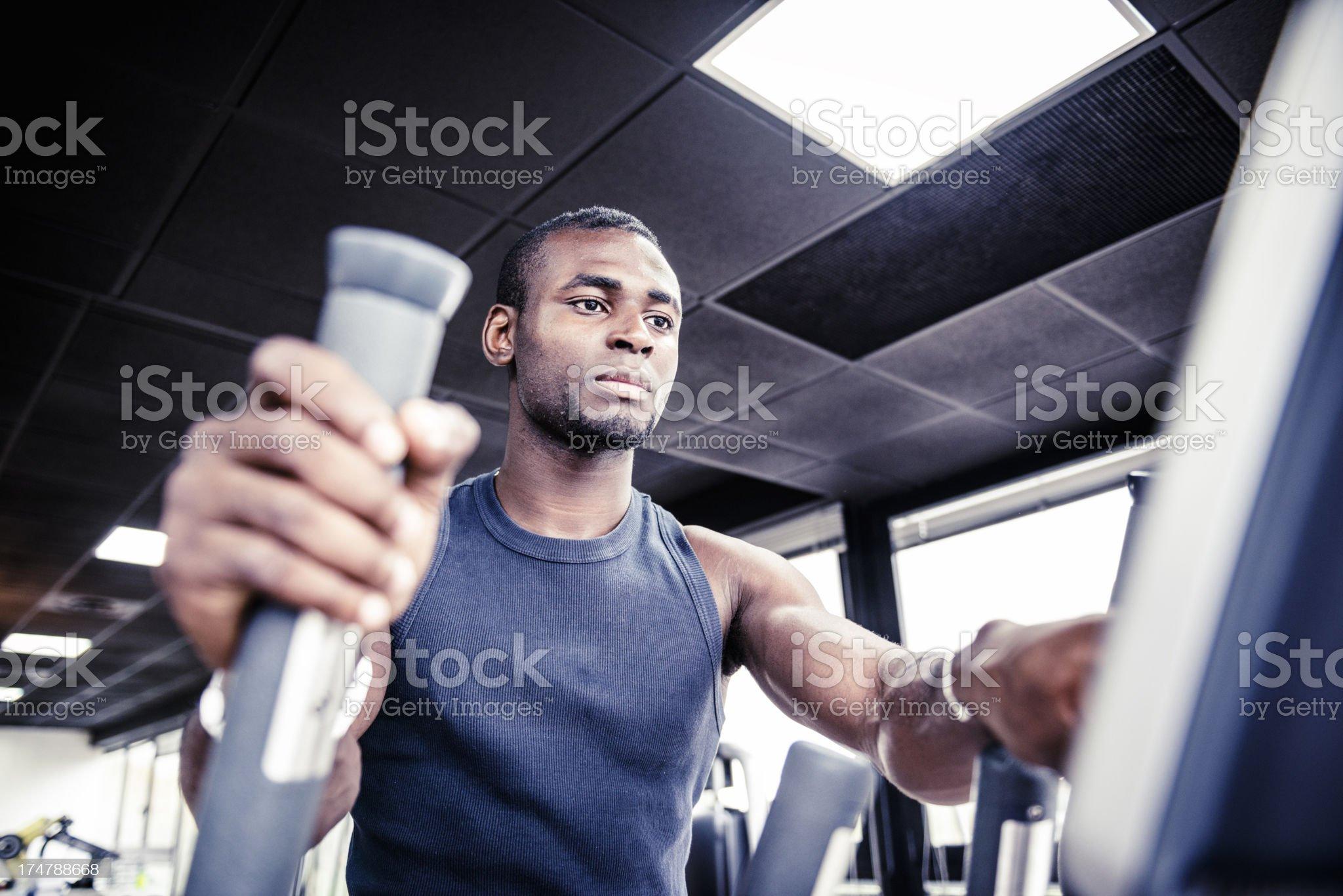 Man on Cardio machine inside a gym royalty-free stock photo