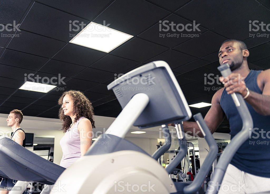 Man on Cardio treadmill machine inside a gym stock photo