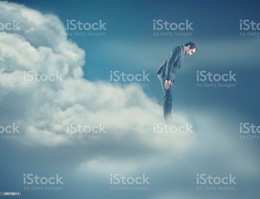 Man on cloud stock photo