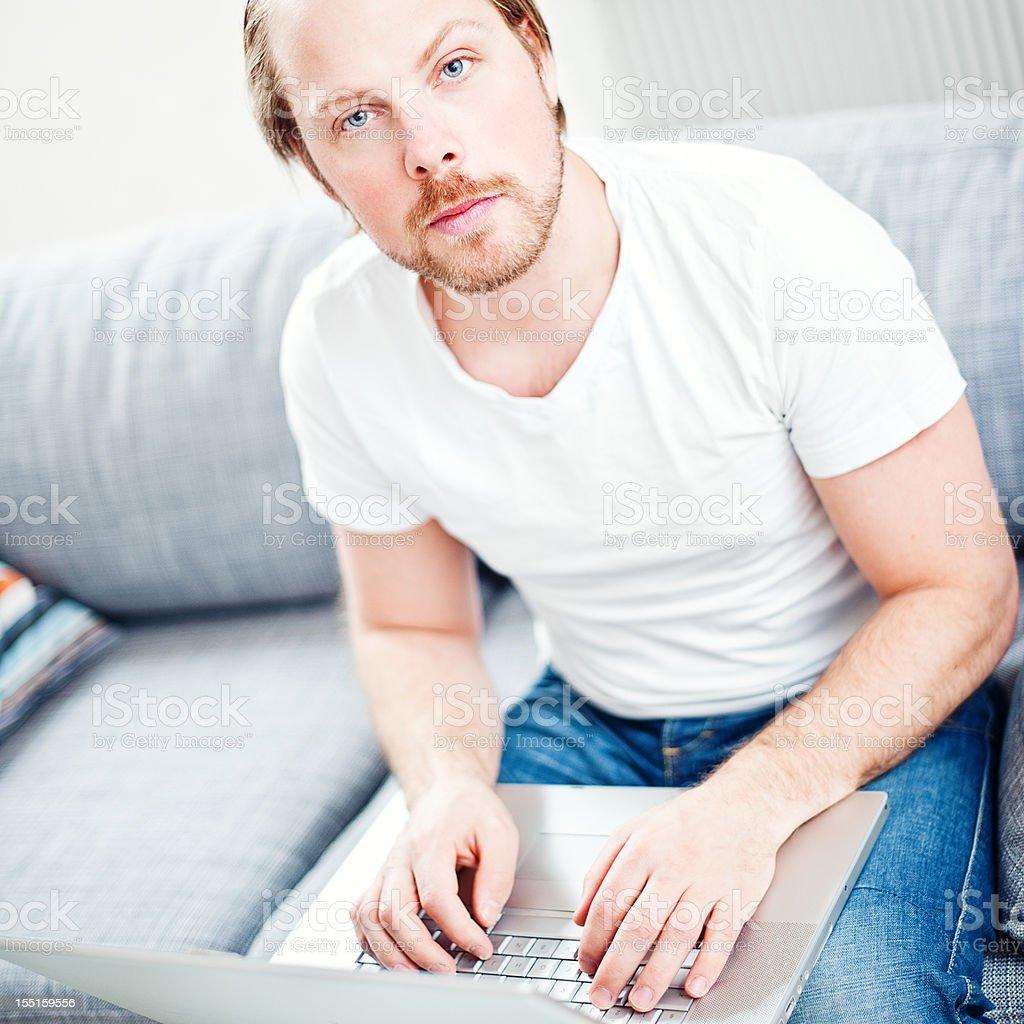 Man on computer royalty-free stock photo
