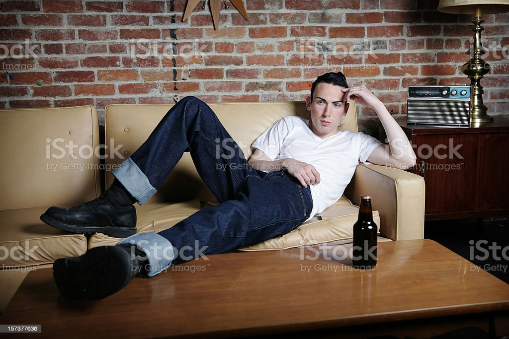 Man on Couch stock photo
