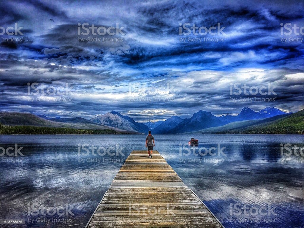 man on dock stock photo